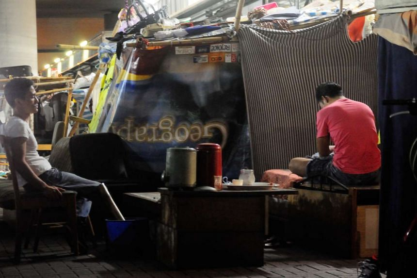There are about 100 people living in this tent city of sorts (above) under a bridge in Sham Shui Po, Kowloon.