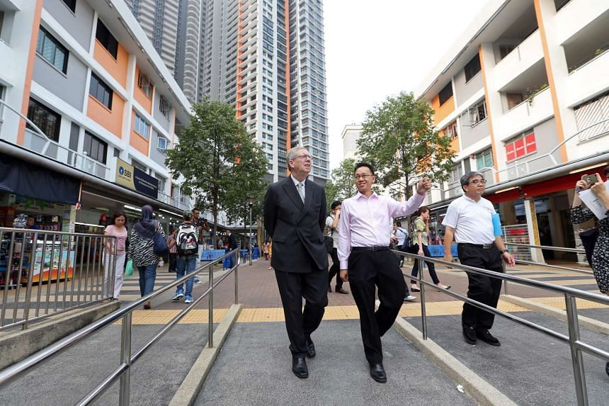 Dr Tan Wu Meng, MP for Jurong GRC, and Sir David Cecil Clementi walking around Clementi Town Centre yesterday. The town was named after Sir David's great-grand uncle, Sir Cecil Clementi Smith.