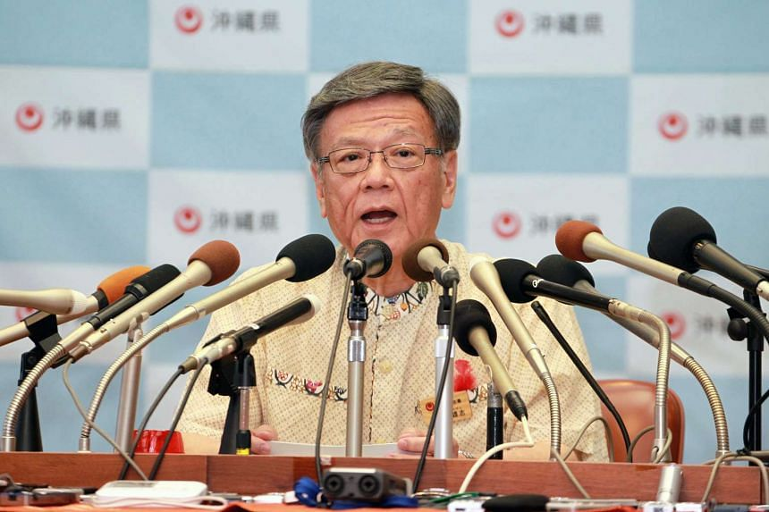 Okinawa Governor Takeshi Onaga speaks during a press conference at the prefectural government's office in Naha, Okinawa island, Japan, on Oct 13, 2015.
