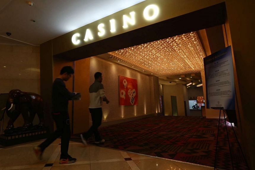 Chinese tourists enter Paradise Casino inside the Jeju Grand Hotel in Jeju, South Korea, on March 16, 2014.