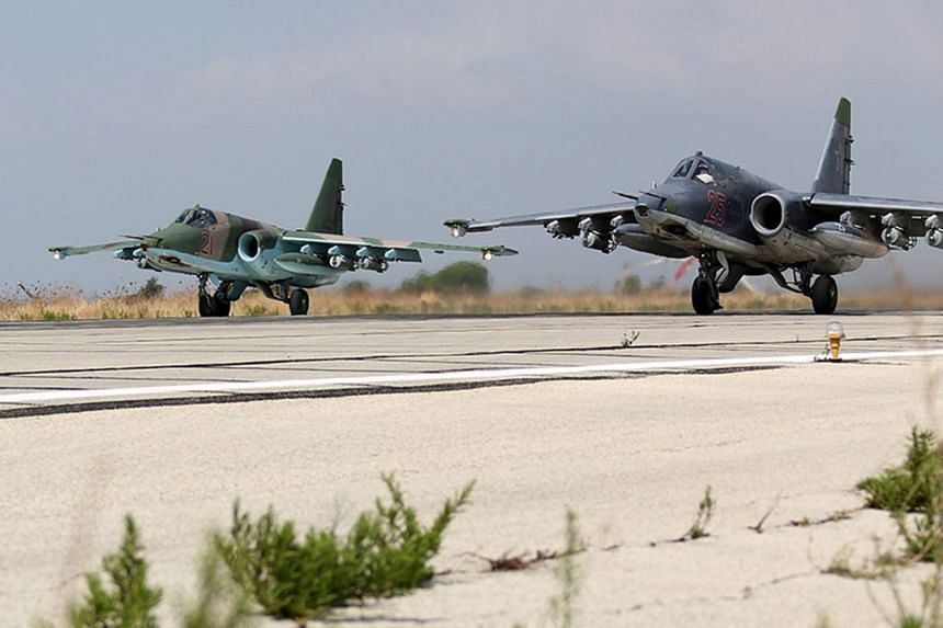 Russian SU-25 strike fighters taking off from Hmeymim airbase, outside Latakia, Syria, on Oct 3, 2015.