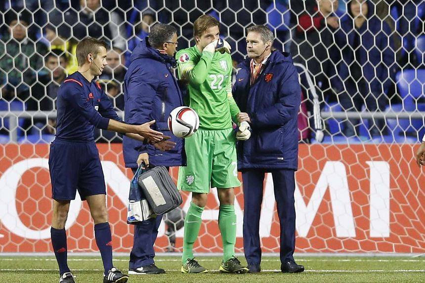 Dutch goalkeeper Tim Krul is helped off the pitch during the Uefa Euro 2016 qualifying round Group A match against Kazakhsan at Astana Arena stadium in Astana, Kazakhstan, on Oct 10, 2015.