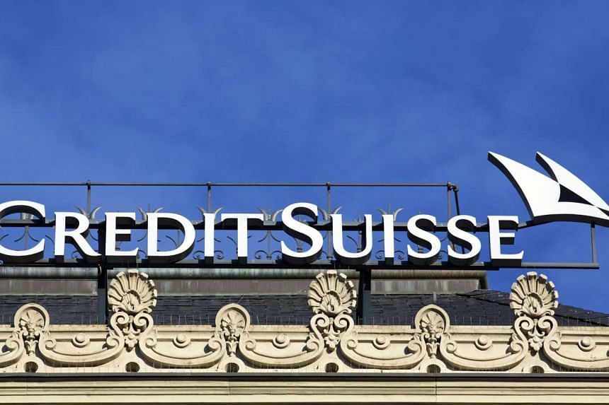 A sign sits atop Credit Suisse Group AG's headquarters in Zurich, Switzerland.