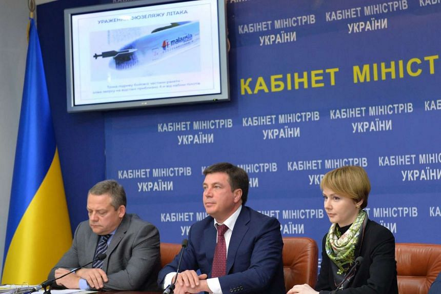 Ukrainian deputy Prime Minister Gennadiy Zubko (centre) and deputy Foreign Minister Olena Dzerkal (right) giving a press conference to present the results of the criminal investigation of the MH17 crash in Kiev on Oct 13, 2015.