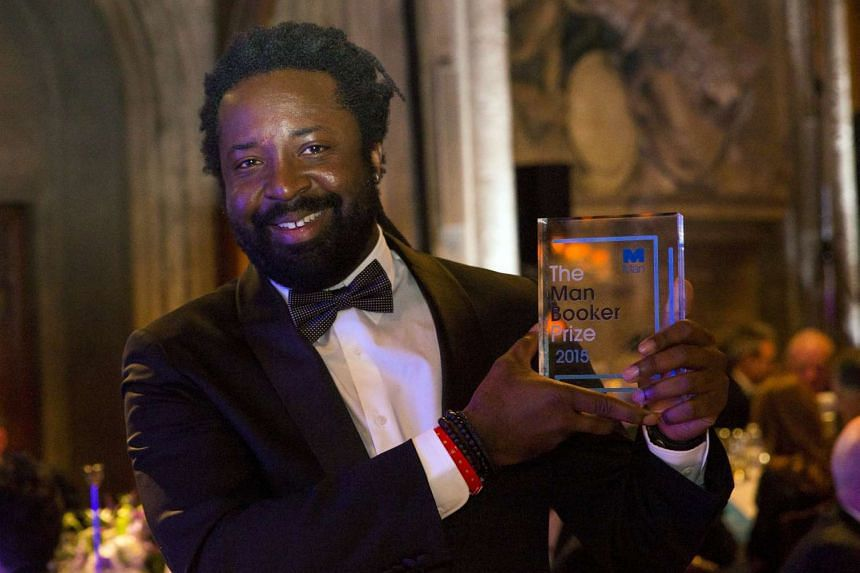 """Marlon James, winning author or """"A Brief History of Severn Killings"""", poses with his award at the ceremony for the Man Booker Prize for Fiction 2015."""