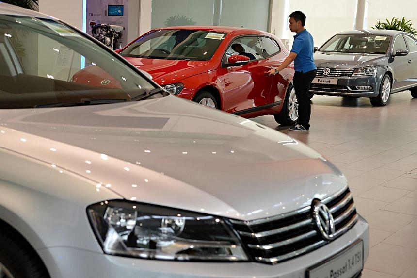 A visitor looking at a car at the Volkswagen Centre showroom.