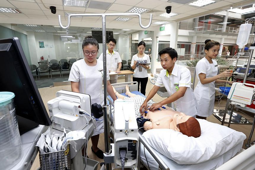 Nursing students in an intensive care unit set up in Ngee Ann Polytechnic School of Health Sciences.