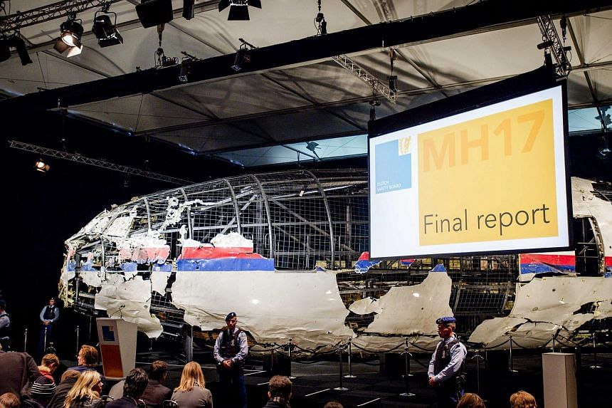 The rebuilt fuselage of Malaysia Airlines flight MH17 during a press conference to present the findings of the Dutch Safety Board.