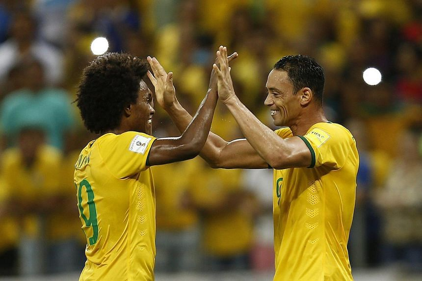 Brazil's Ricardo Oliveira (right) and Willian celebrate after scoring against Venezuela, during their qualifying football match for the Russia 2018 World Cup.