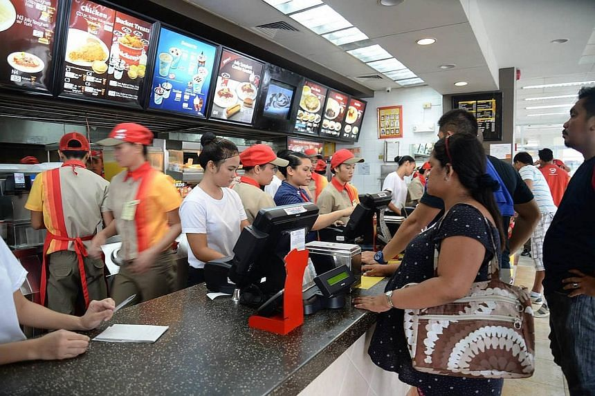 Fast-food giant Jollibee Foods (right) has acquired part of Smashburger, which has 339 restaurants globally.