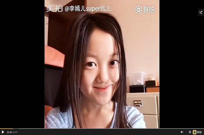 Li Yan doing an impression of her mother, Faye Wong, taking selfies (above) and giving fans make-up tips.