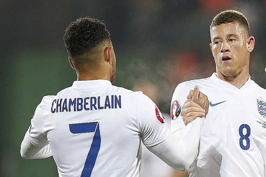 Ross Barkley shows the way again, celebrating with Alex Oxlade-Chamberlain after scoring the first goal for England. He was named Man of the Match in the qualifier against Estonia on Friday.