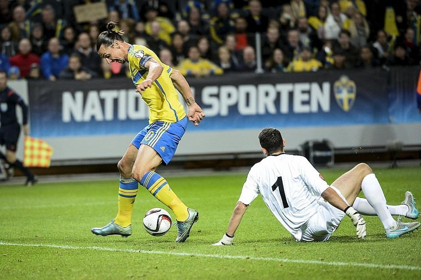 Sweden's Zlatan Ibrahimovic dribbling the ball past Moldova 'keeper Ilie Cebanu to score the opening goal. Despite the 2-0 victory, Russia's storming finish means the Swedes must win a play-off to avoid missing a second straight major tournament.