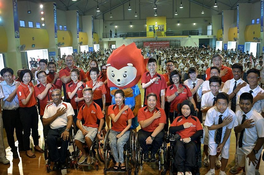 Minister for Culture, Community and Youth Grace Fu (middle row, fifth from left) and Senior Minister of State, Ministry of Culture, Community and Youth and Ministry of Finance Sim Ann (middle row, second from left) joined para-athletes yesterday to d