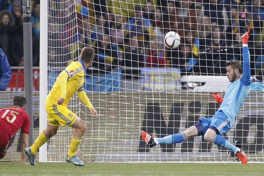 David de Gea, turning away a shot from Ukraine's Ruslan Rotan, produced an inspired performance to bolster his prospects of replacing veteran goalie Iker Casillas.