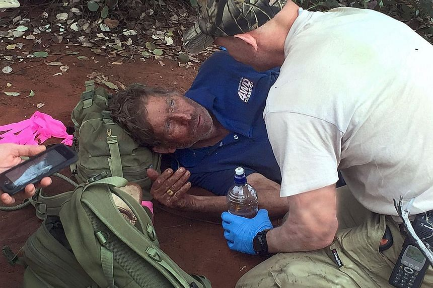 A police tracker comforting Mr Reg Foggerdy, 62, who disappeared on Oct 7 while heading on a hunting trip to the Shooter's Shack camp near Laverton in the West Australian goldfields, some 950km north-east of Perth. Mr Foggerdy survived for six days i