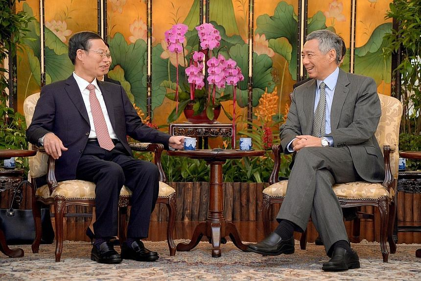 Chinese Vice-Premier Zhang Gaoli calling on PM Lee Hsien Loong at the Istana, where they reaffirmed close bilateral ties. Mr Lee said he is looking forward to Chinese President Xi Jinping's state visit next month.