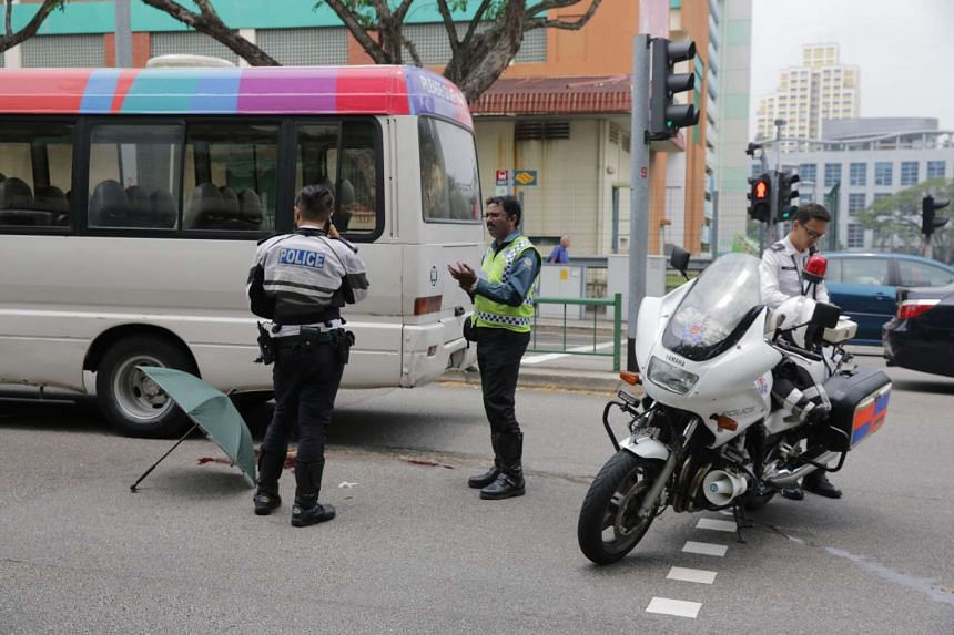 Police officers at the scene of the accident.