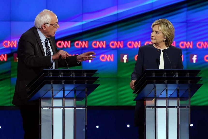 Democratic presidential candidates Senator Bernie Sanders (left) and Hillary Clinton take part in a presidential debate at Wynn Las Vegas on Oct 13, 2015.