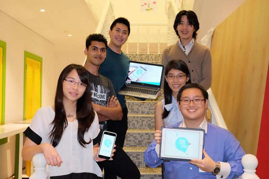 The winning team at the Hyper Haze Hack hackathon, Hazero, came up with an app idea to give people practical health advice on what to do based on PSI levels at their very location. (From bottom left, clockwise) Kexin Yu, 24; Ravi Gandhi, 26; Quah Kok