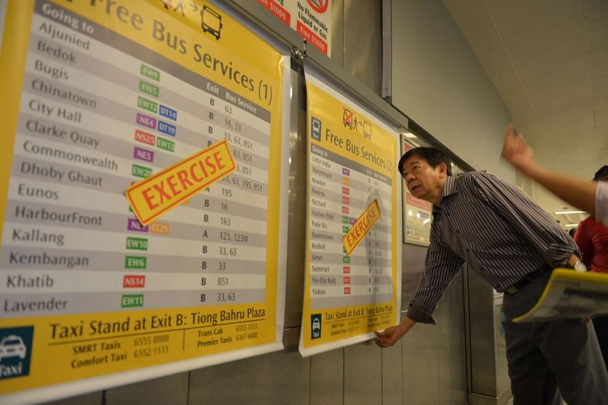 Minister for Transport Khaw Boon Wan looks at the pull charts that will be in place to guide commuters to the buses they can take.