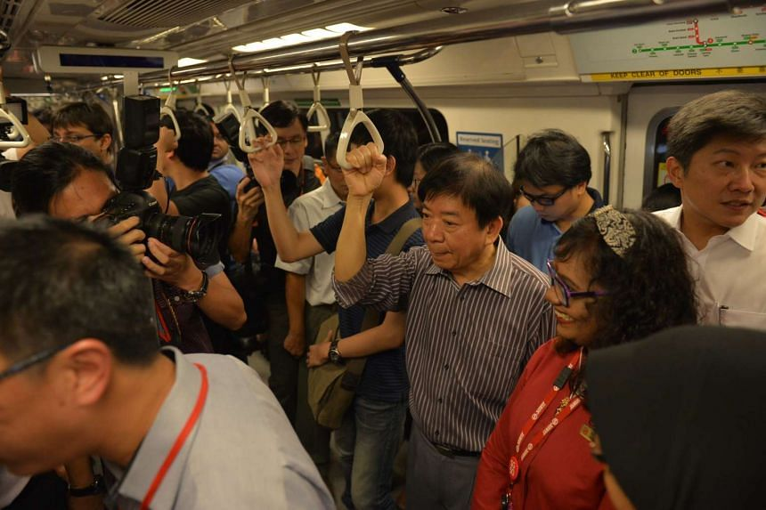Minister for Transport Khaw Boon Wan taking the train from Tiong Bahru station to Outram station. With him is Senior Minister of State for Transport Ng Chee Meng (right in white).
