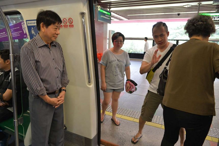 Minister for Transport Khaw Boon Wan at Redhill station as he takes the train from Outram station to Bouna Vista station.