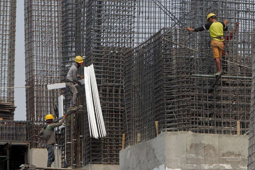 Workers at a construction site in Jakarta, Indonesia, on Oct 5, 2015.