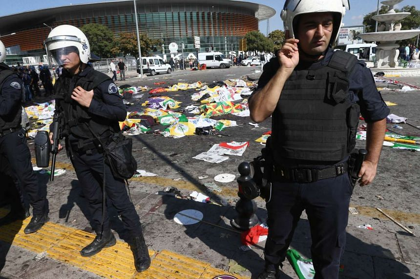 Turkish riot police forces secure the site of twin explosions, near the main train station in Turkey's capital Ankara, on Oct 10, 2015.