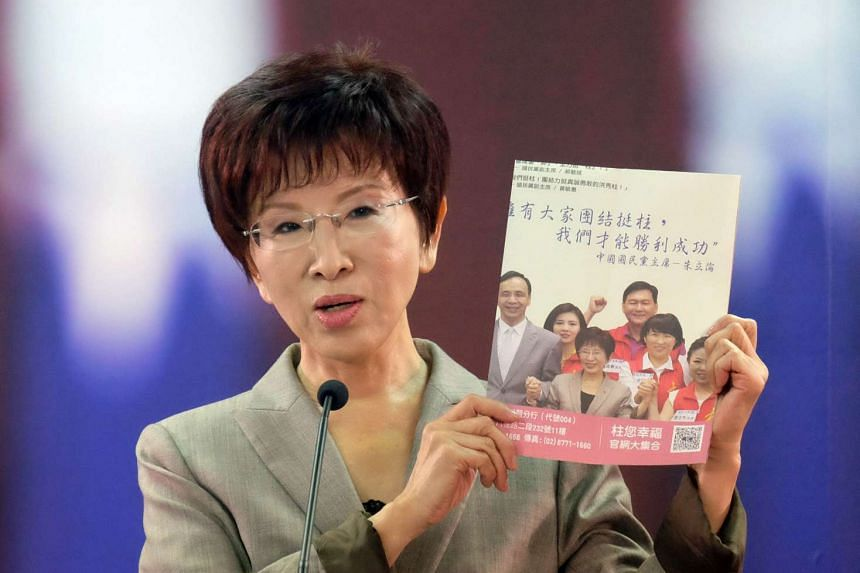 Kuomintang presidential candidate Hung Hsiu-chu displays a campaign poster made during a press conference in Taipei on Oct 6, 2015.