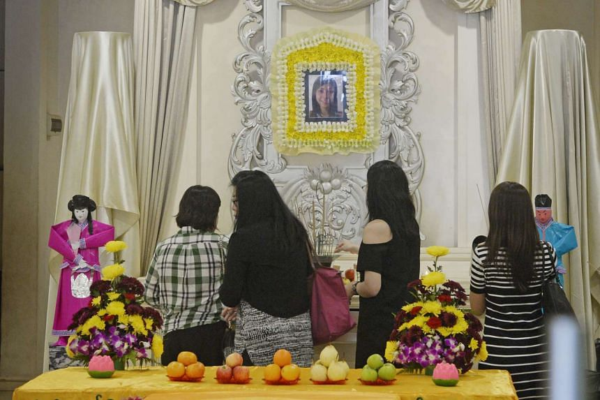 Colleagues of the late chemist Lim Siaw Chian, who was a victim of a fire that broke out at Leeden National Oxygen, visit her wake in Skudai, Johor, on 14 Oct, 2015.
