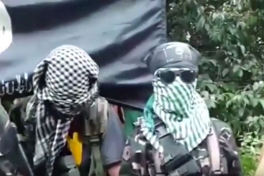Militants hide their faces in a screenshot from the online video.