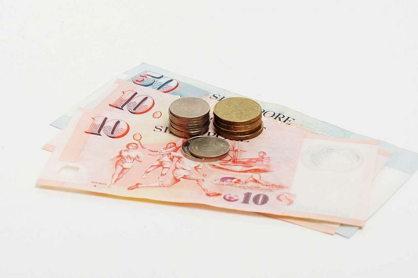 Singapore dollar notes and coins.