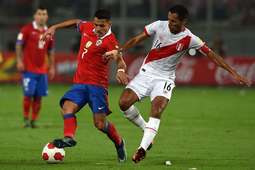 Chile's Alexis Sanchez (left) and Peru's Carlos Lobaton vie for the ball during their Russia 2018 Fifa World Cup South American Qualifiers football match.