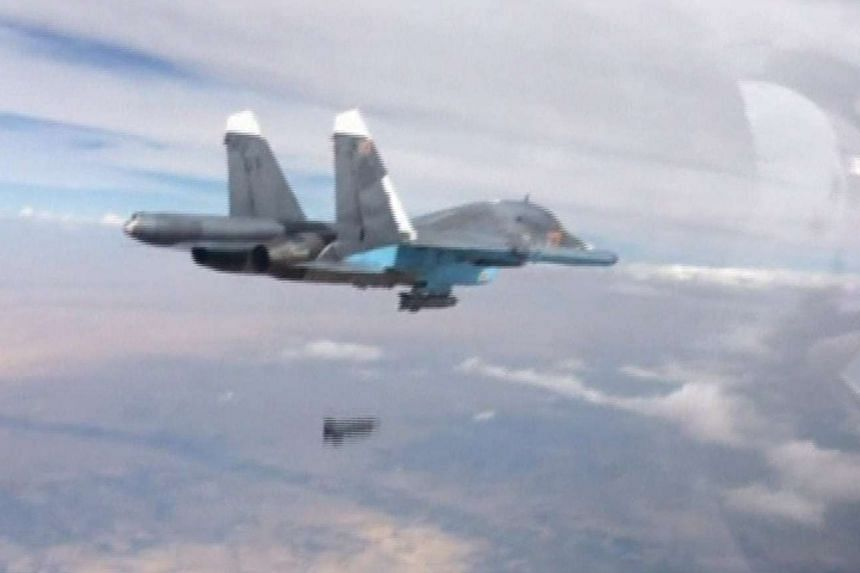 A frame grab taken from footage released by Russia's Defence Ministry shows a Russian Su-34 fighter-bomber dropping a bomb in the air over Syria.