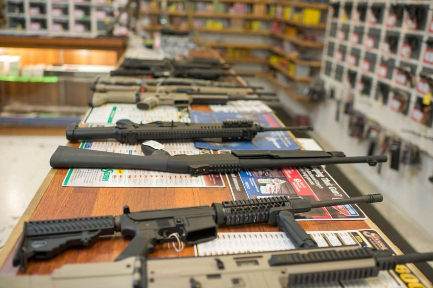 Guns are on display at Roseburg Gun Shop in Roseburg, Oregon in the US, where  a lone gunman shot at students and killed nine on the Umpqua Community College campus early this month.