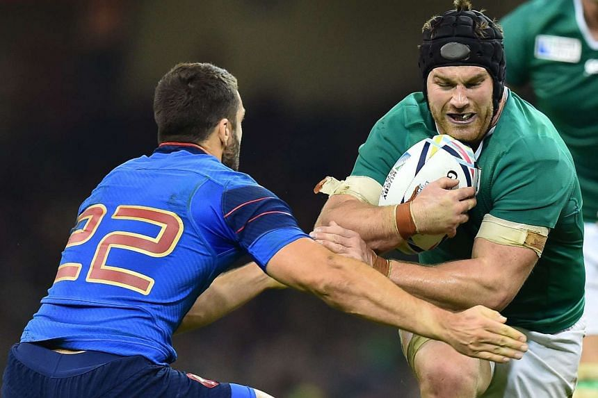 France's fly half Remi Tales (left) tackles Ireland's flanker Sean O'Brien during a Pool D match of the 2015 Rugby World Cup between in Cardiff, Wales, on Sunday.