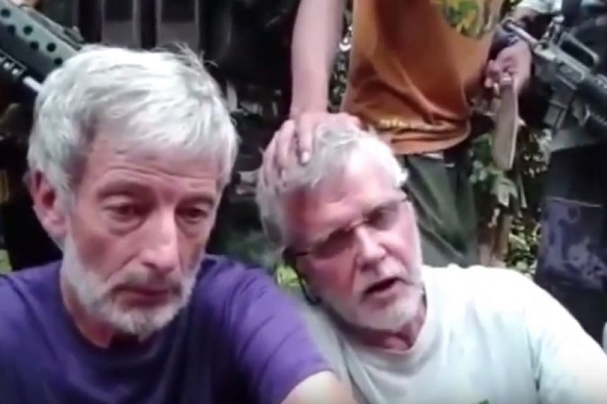 A screenshot from the video posted online, showing Robert Hall (left) and John Ridsdel.