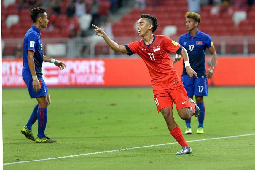 Faris Ramli celebrating his goal in the first half of the World Cup qualifying match between Singapore and Cambodia.