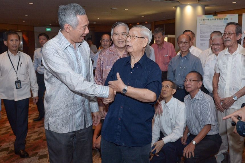 Prime Minister Lee Hsien Loong greeting Mr Wong Wei Kong, 92, his former Chinese language teacher, at Catholic High School's 80th founder's day dinner at the Fairmont Hotel last night.