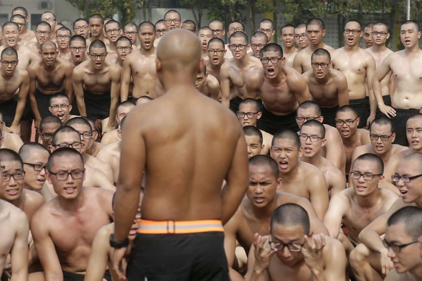 "Recruits gathering for a briefing during physical training at the Basic Military Training Centre in Pulau Tekong yesterday. Mr Ong says there are ""synergies"" between his education and defence portfolios."