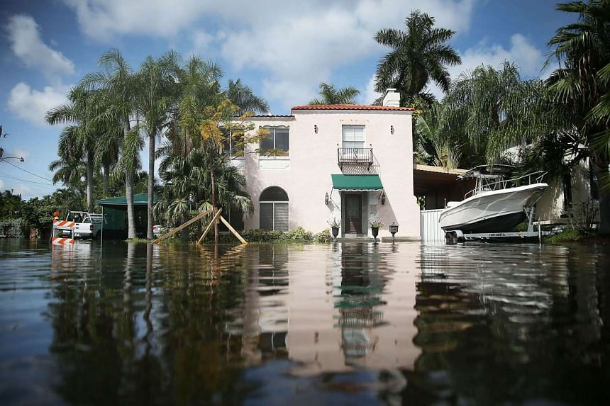 A Florida home surrounded by flood water caused by seasonal high tides and what many believe is the rising sea level due to climate change. A new study says it is already too late to save Miami and New Orleans in the US from sinking below rising seas