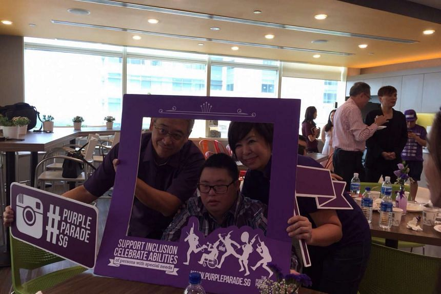 Mr Goh Jin Kian, seen here flanked by his parents Goh C.S. and Margaret Goh, is one of seven chosen as the face of The Purple Parade.