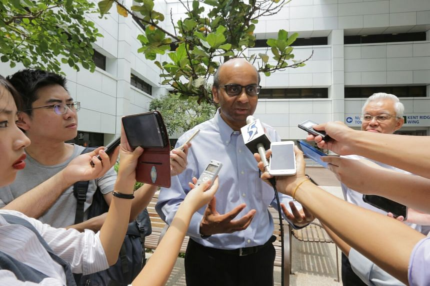DPM Tharman speaking to reporters outside NUH, after visiting lift accident victim Khoo Bee Hua.
