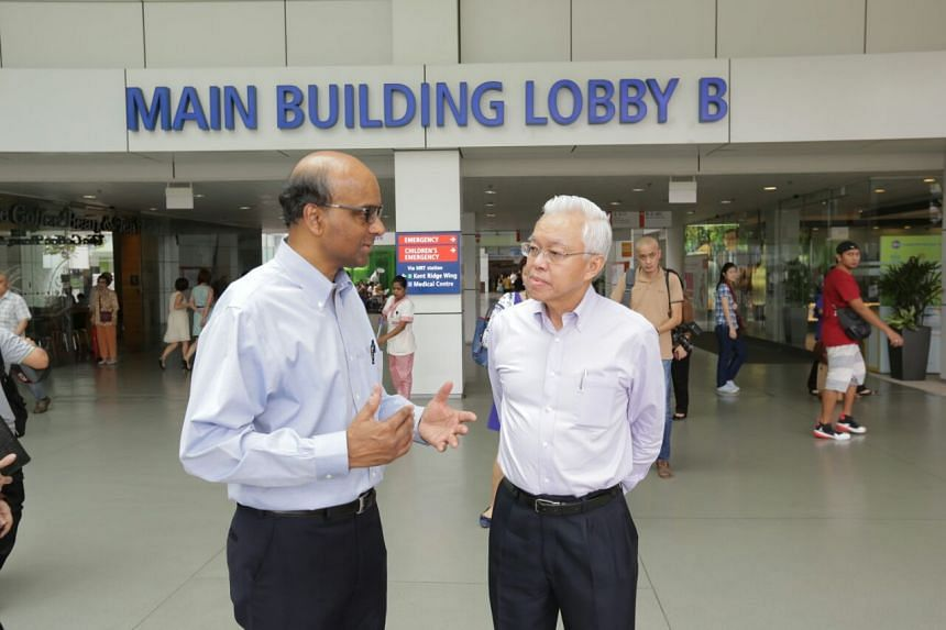 DPM Tharman speaking to Taman Jurong Citizens Consultative Committee chairman Goh Peng Tong outside NUH.