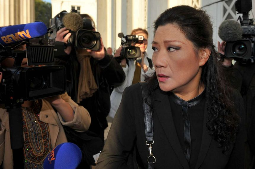 "Lise Han (above right) stands accused of fraud in the so-called ""Chinese Wedding"" case."