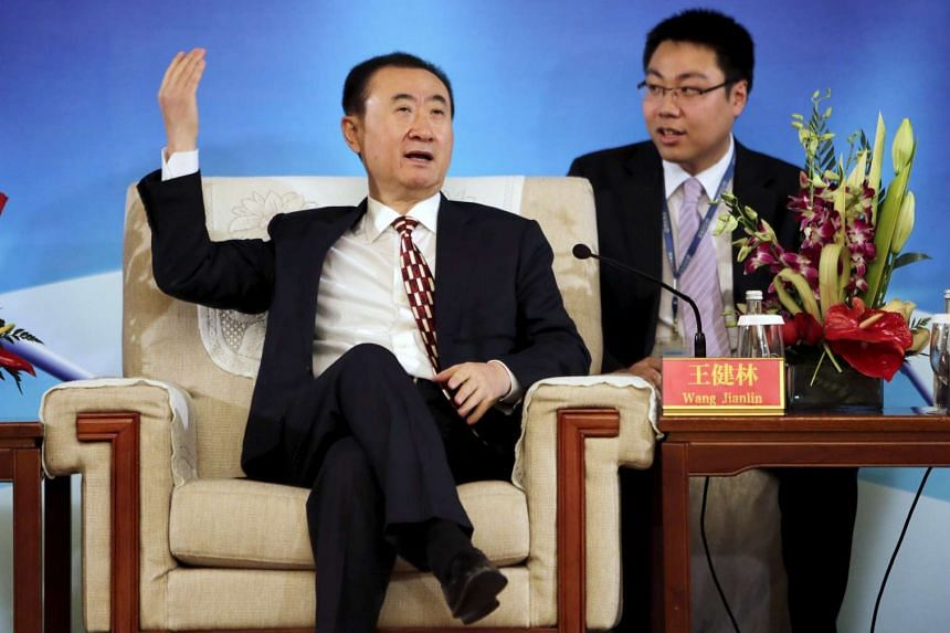 Wang Jianlin, chairman of Dalian Wanda Group, gestures as he speaks ahead of a signing ceremony in Beijing in this January.