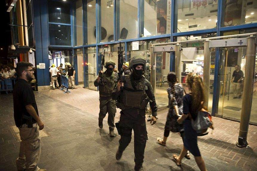 Israeli special forces walk out of the Central Jerusalem Bus Station after police said a woman was stabbed by a Palestinian there, on Oct 14, 2015.