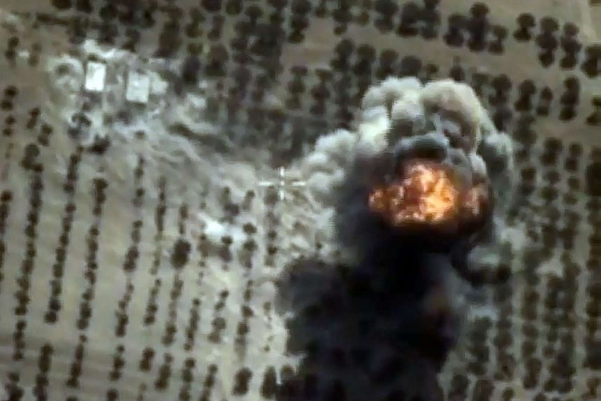 An explosion is seen after an airstrike at what Russia says is an ISIS facility in Idlib province in Syria, in an image taken the Russian Defence Ministry's official website.