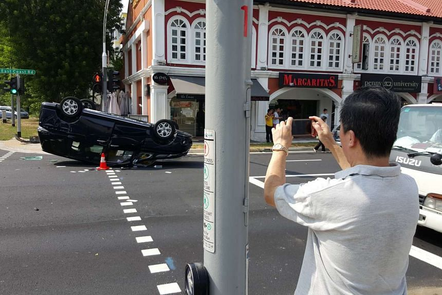 A car flipped over at the junction of East Coast Road and Telok Kurau Road at about 9.30am on Oct 15, 2015.